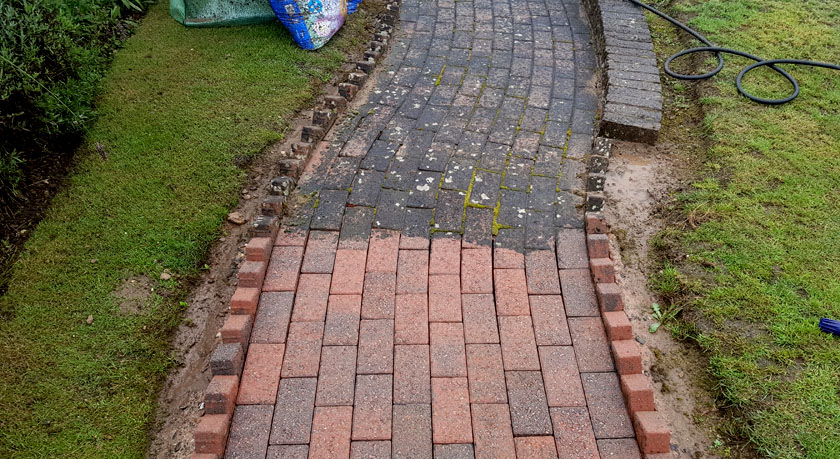 block paving being cleaned